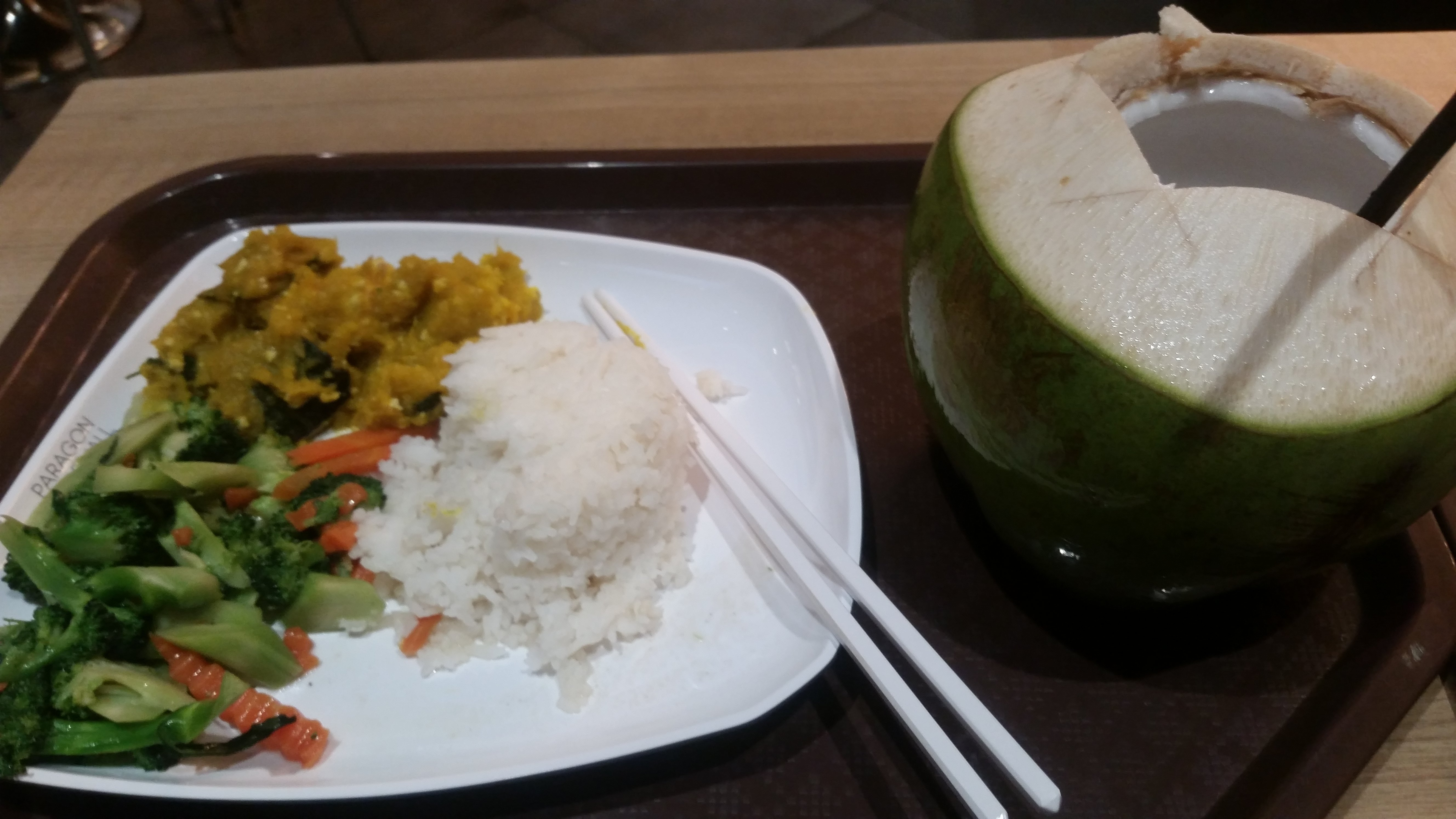 Rice with roast pumpkin, tofu, and veggies, and a coconut to drink!