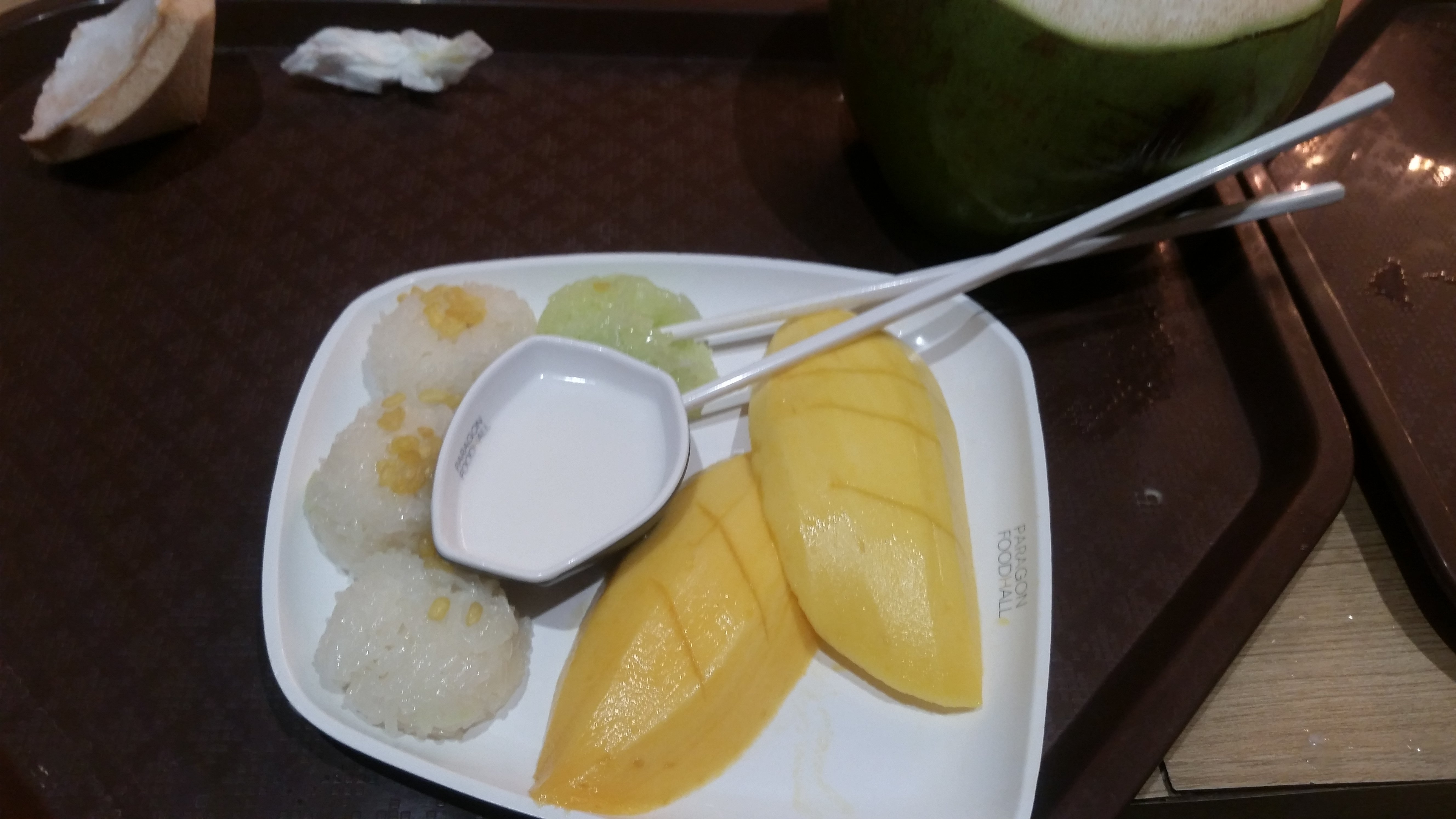 Mango sticky rice, an incredibly tourist-y meal. Served with Coconut Milk.