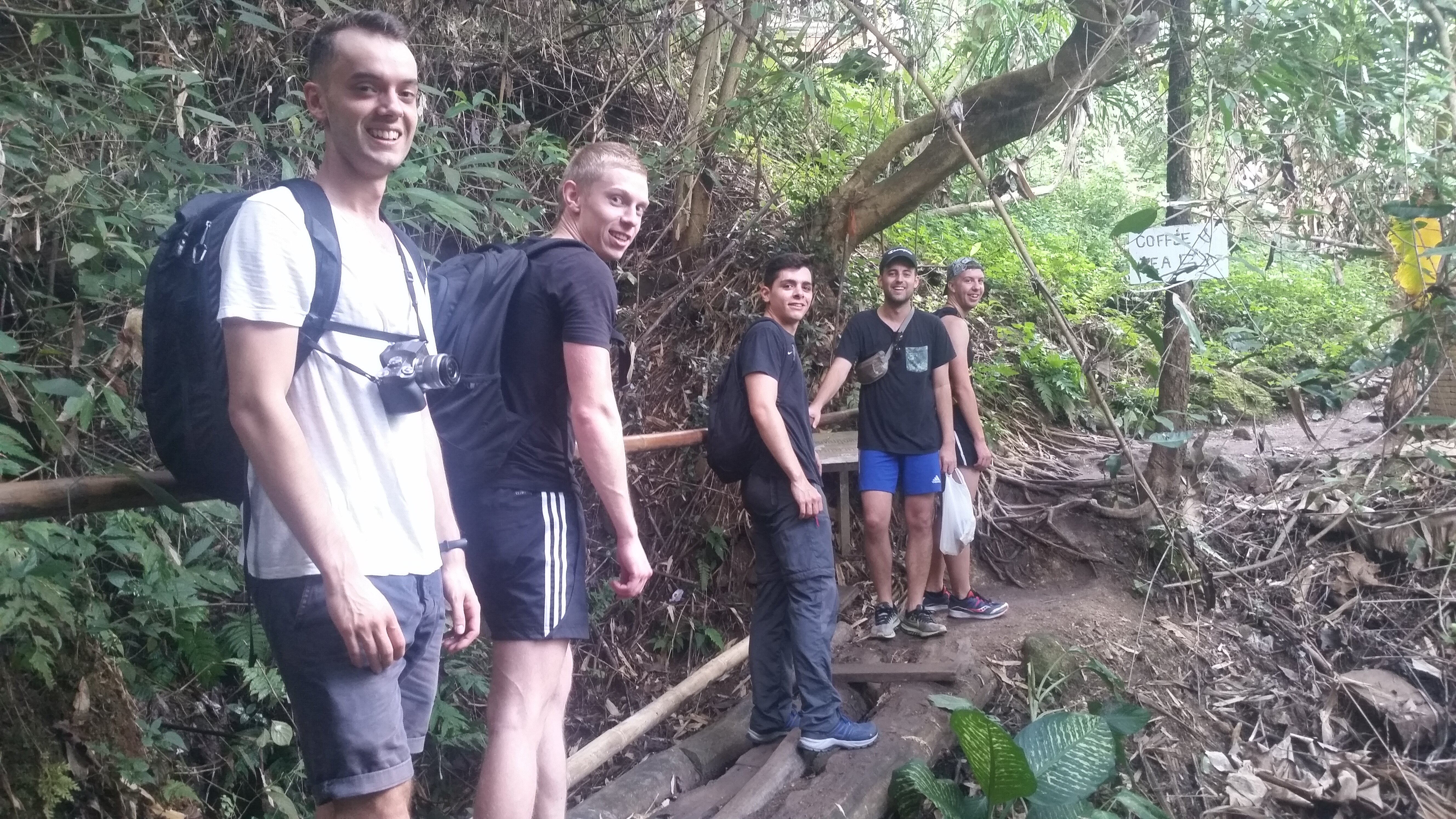 Crossing a small wooden bridge before the hidden temple.