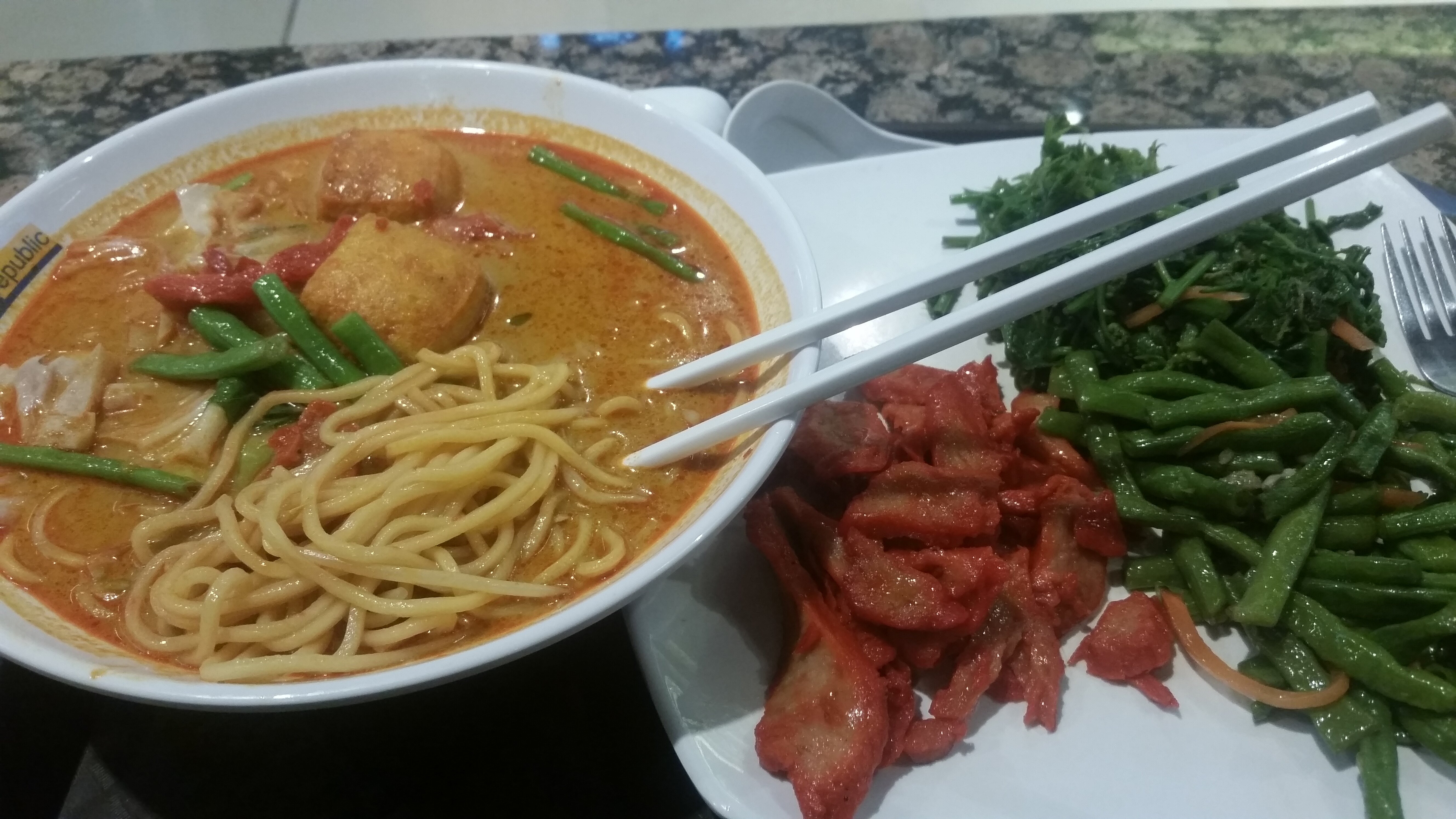 Curry Noodles with a handful of side dishes from the Vegetarian stand in the Food Republic food court in Pavilion.