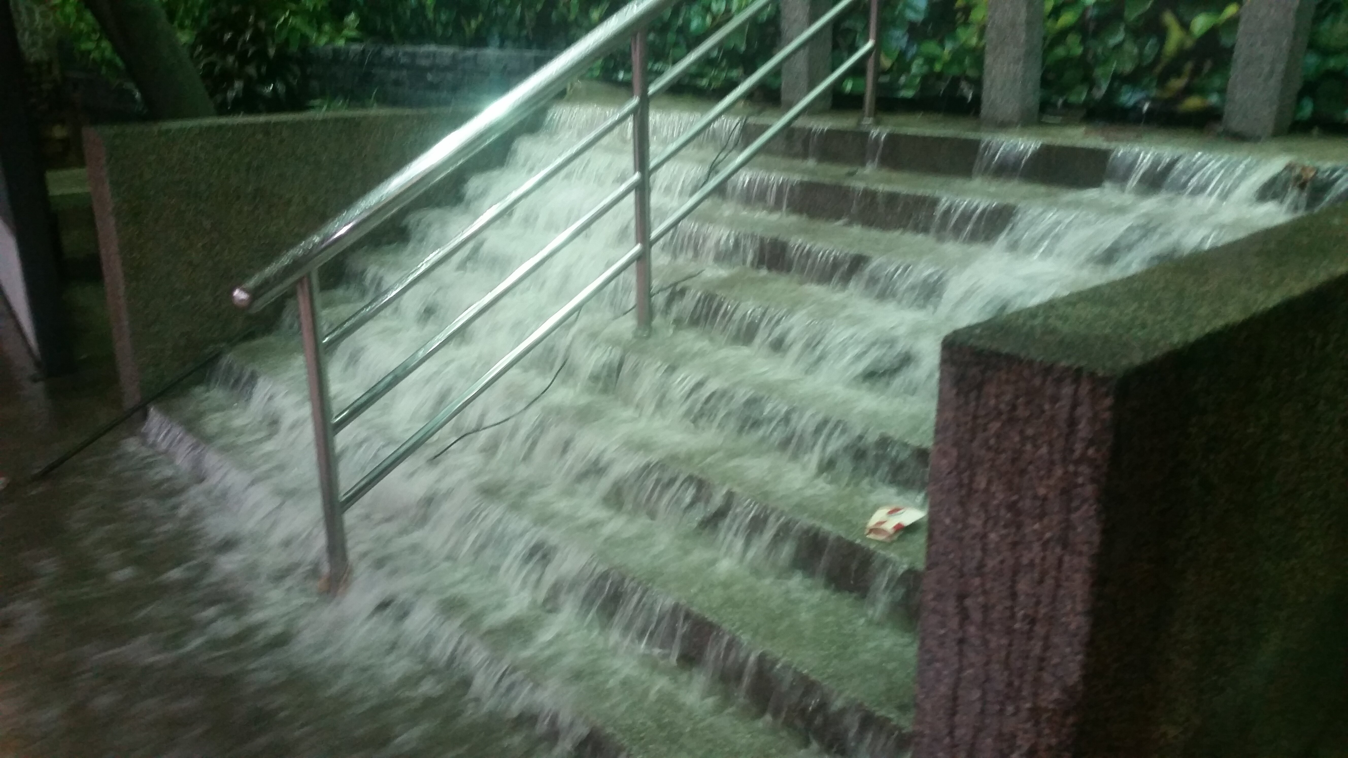 Stairs turned into a waterfall during heavy rainfall.