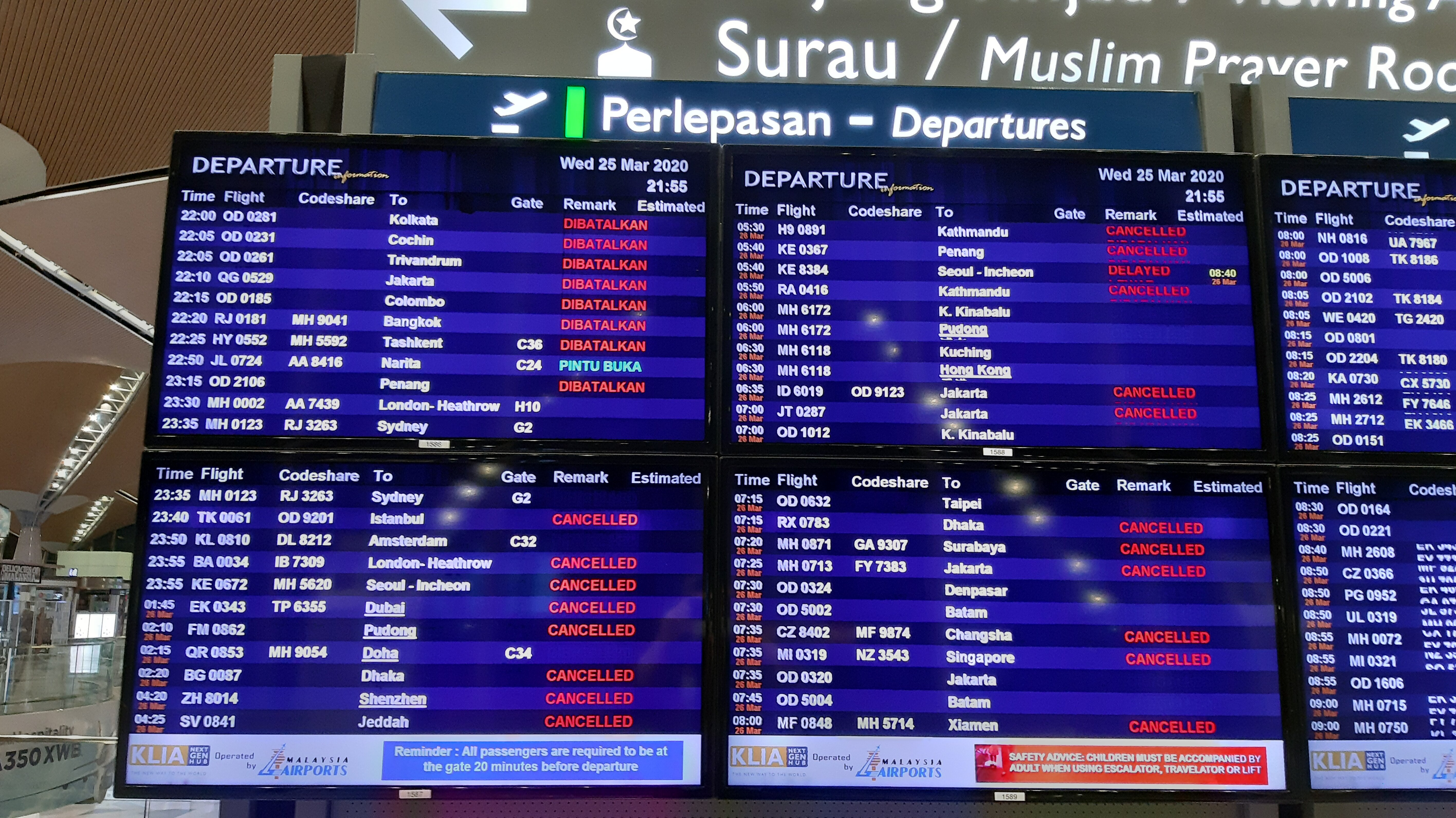 Board showing cancelled flights in KLIA airport.