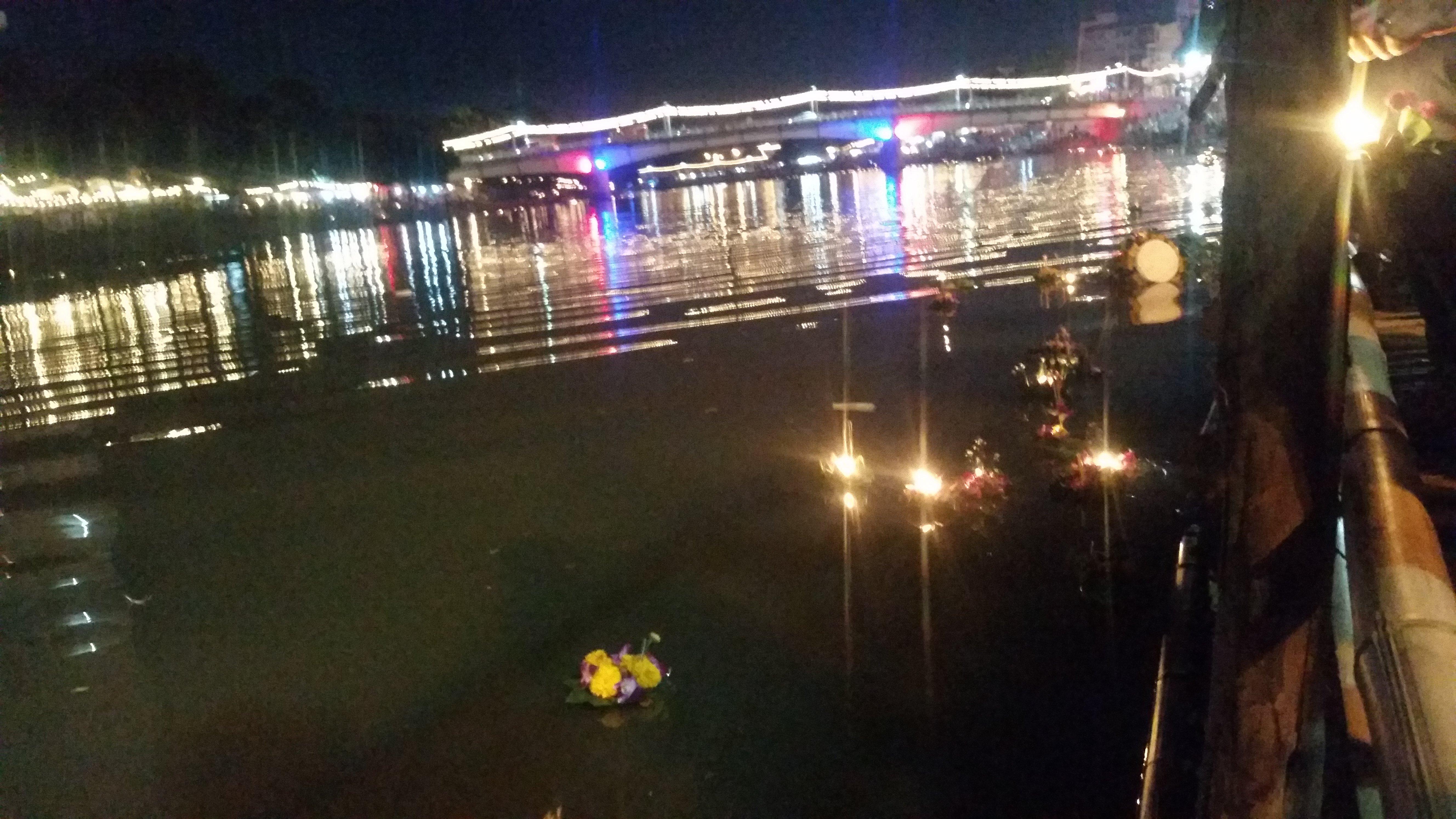 Krathong floating peacefully downriver.