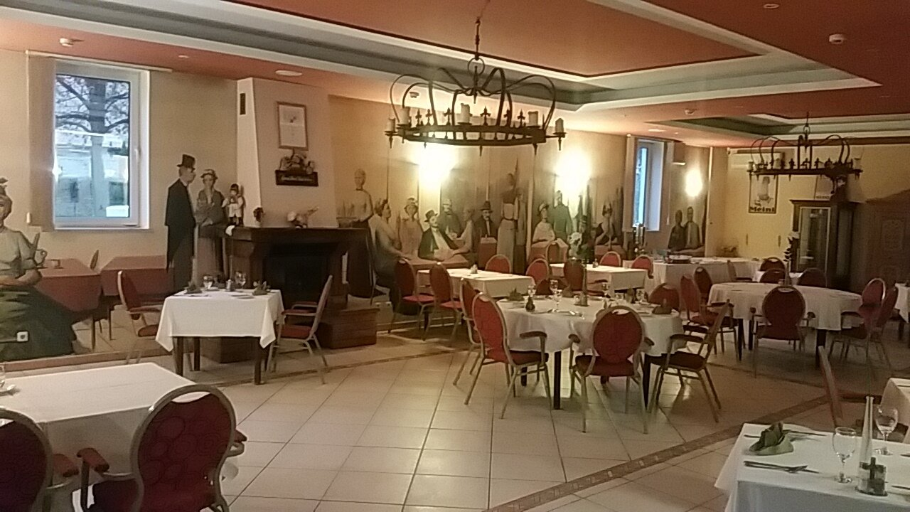 Dining Room at Hotel Kralj Tomislav. Supposedly the murals on the wall are images of some part of Croatia's history.