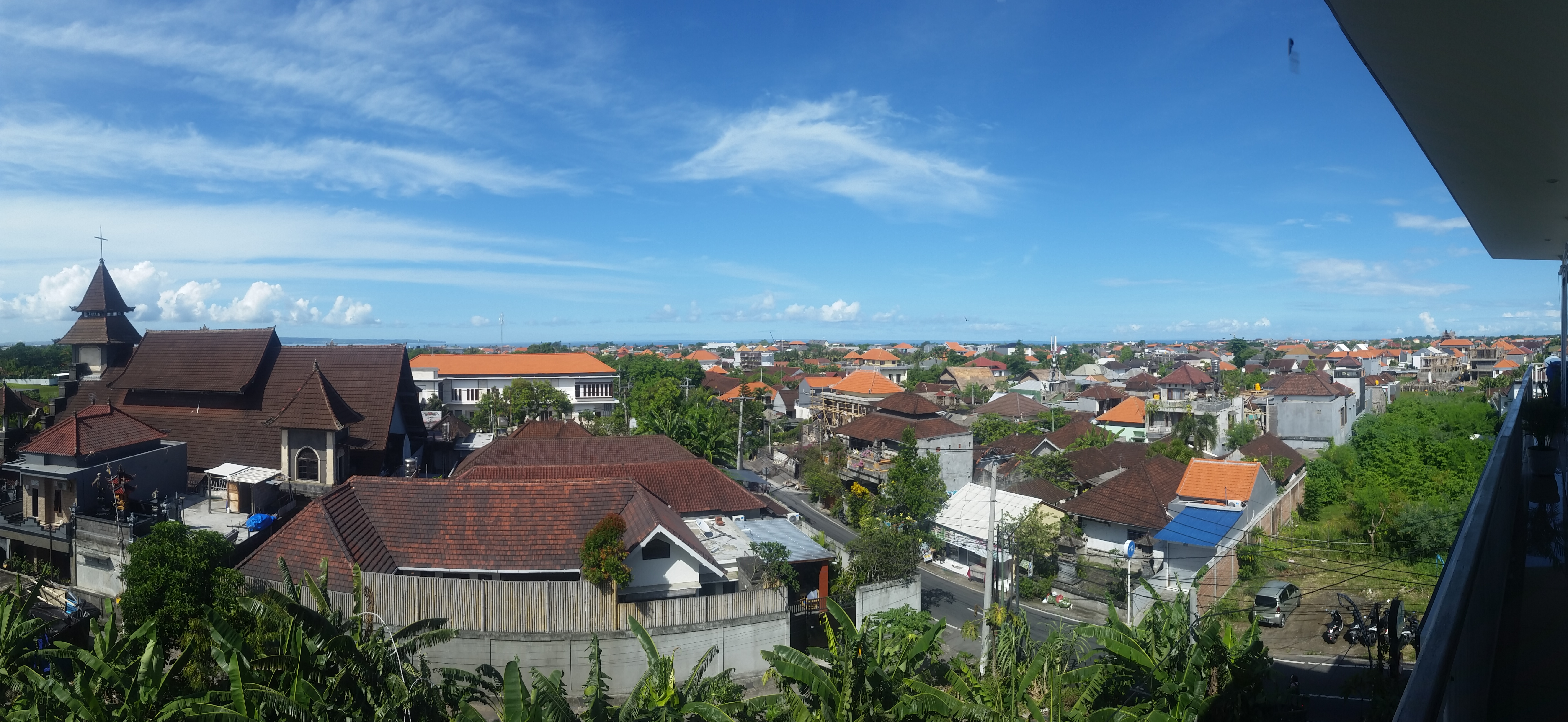 View from Matra's south window on to residences in Canggu. In the distance you can see a sliver of ocean and also some parts of Bali Selatan like Jimbaran.