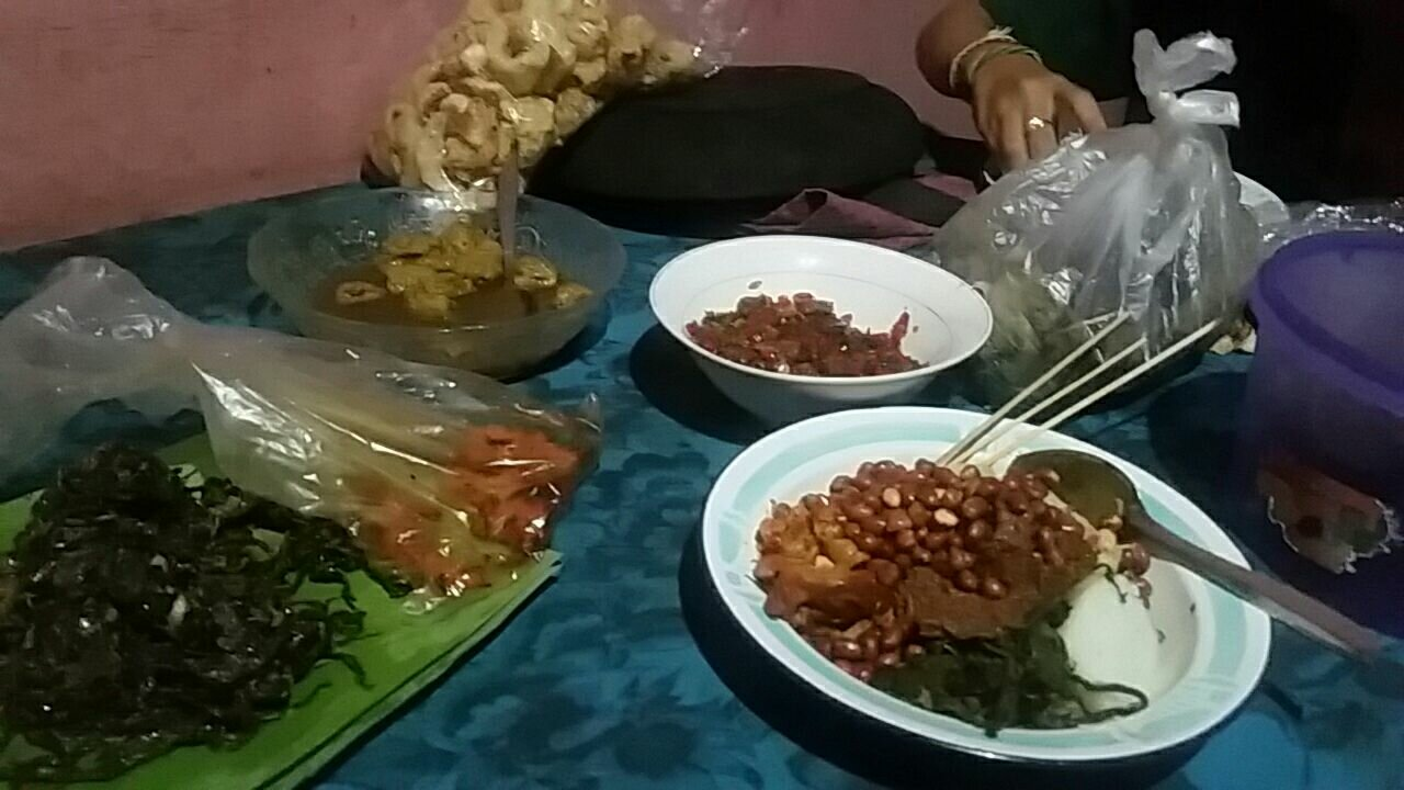 Eating delicious Indonesian food.