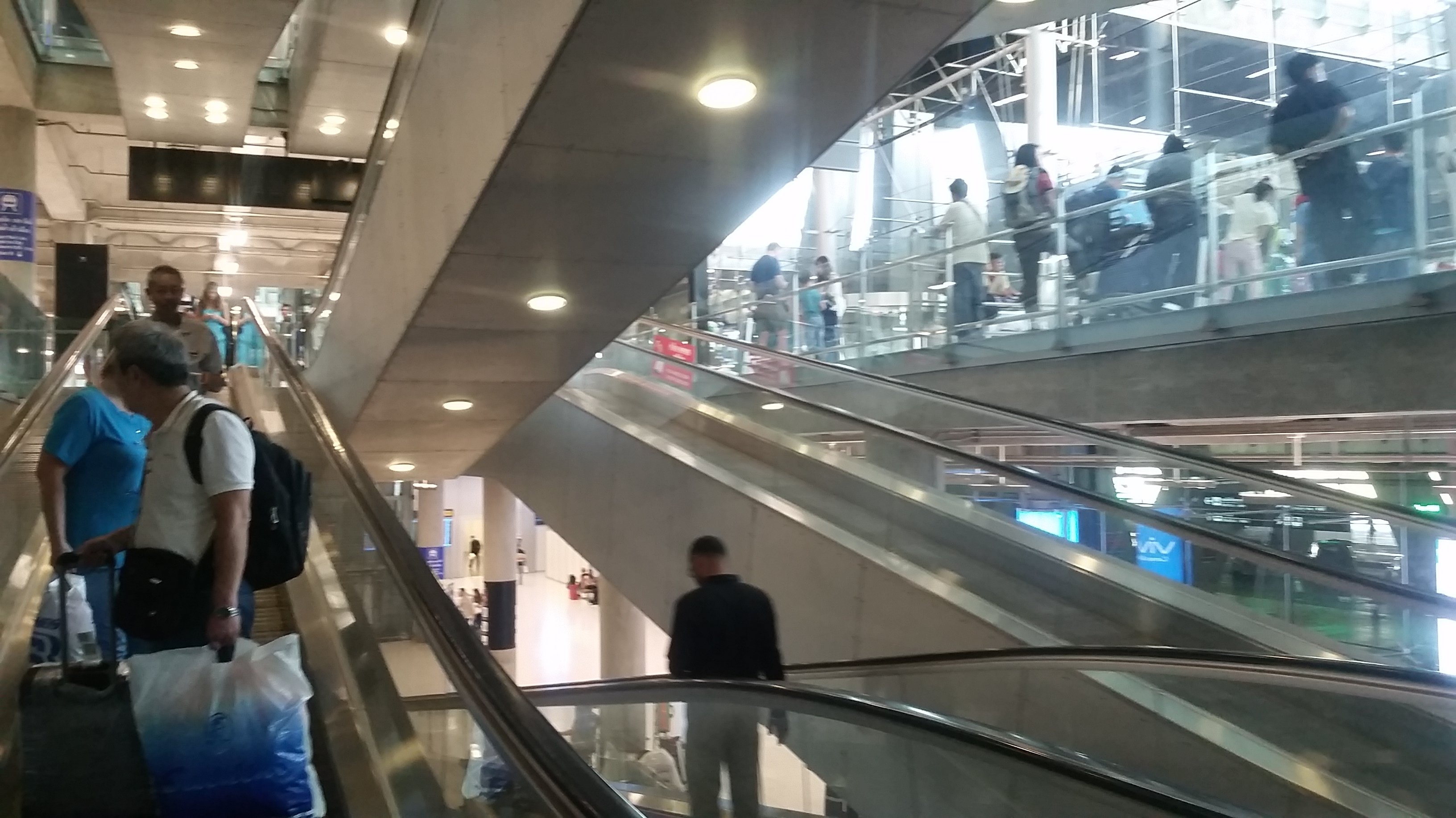 Taking the escalator down to the Airport Rail Link.